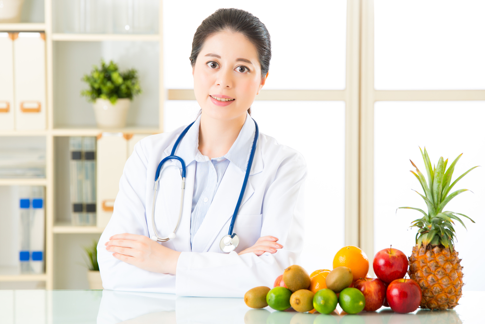 Doctor nutritionist with fruits